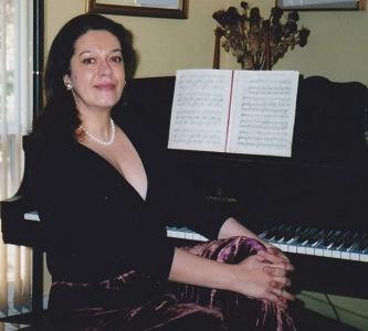 Georgiana Rosca posing at her piano